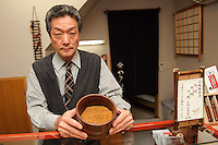 Kuronuma Akira holds a bowl of shichimi, Yagenbori shichimi, Asakusa, Tokyo, Japan, February 19, 2011.Yagenbori, founded in 1625 was the first to produce the now popular Japanese condiment.