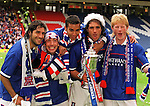 Gabriel Amato, Derek McInnes, Giovanni van Bronckhorst, Lorenzo Amoruso and Colin Hendry celebrate after winning the Scottish Cup