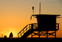 A photographer shoots the sunset at 5:58pm in Santa Monica on Saturday, November 5, 2011.