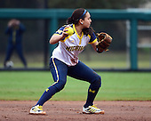 Michigan Wolverines shortstop Sierra Romero (32) throws to first during the season opener against the Florida Gators on February 8, 2014 at the USF Softball Stadium in Tampa, Florida.  Florida defeated Michigan 9-4 in extra innings.  (Copyright Mike Janes Photography)