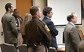 Sniper suspect John Allen Muhammad, left, stands along with his defense team, Peter Greenspun and Jonathan Shapiro as the judge adjourned the court in the trial of sniper suspect John Allen Muhammad in courtroom 10 at the Virginia Beach Circuit Court in Virginia Beach, Virginia on November 14, 2003.  The jury will resume deliberations Monday morning, November 17, 2003.  <br /> Credit: Davis Turner - Pool via CNP