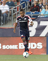 New England Revolution midfielder Juan Agudelo (10) brings the ball forward.  In a Major League Soccer (MLS) match, the New England Revolution (blue) tied D.C. United (white), 0-0, at Gillette Stadium on June 8, 2013.