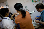 Dr. James Brandt, of Sacramento, prepares to examine a patient's eye after preforming surgery to reduce the pressure due to glaucoma at the Ho Chi Minh City Eye Hospital on Friday, April 18, 2008. Kevin German /  kevin@kevingerman.com..ORBIS Flying Eye Hospital brought doctors, nurses and specialists from all over the world to Ho Chi Minh City, Vietnam from April 7-18, 2008.  The ORBIS program contributed to the efforts of Ho Chi Minh City Eye Hospital in fighting avoidable blindness by educating local ophthalmologists to diagnose and manage pediatric blindness, retinal disease, oculoplastics, and blindness due to glaucoma.