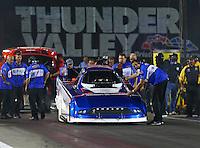 Jun 17, 2016; Bristol, TN, USA; Crew member with NHRA funny car driver Dave Richards during qualifying for the Thunder Valley Nationals at Bristol Dragway. Mandatory Credit: Mark J. Rebilas-USA TODAY Sports