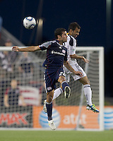 New England Revolution midfielder Benny Feilhaber (22) and Los Angeles Galaxy midfielder Juninho (19) battle for head ball. In a Major League Soccer (MLS) match, the Los Angeles Galaxy defeated the New England Revolution, 1-0, at Gillette Stadium on May 28, 2011.