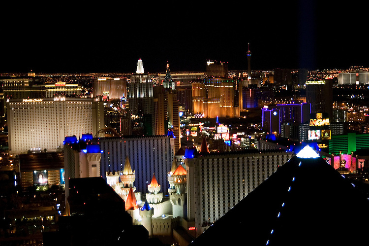 Nevada, NV, Las Vegas, city at night, nightscape, aerial, Las Vegas Strip from Mix Club at Mandalay Bay Hotel, Pyramid of the Luxor Hotel in the foreground, Photo nv255-18712..Copyright: Lee Foster, www.fostertravel.com, 510-549-2202,lee@fostertravel.com