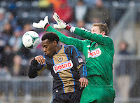 Amobi Okugo (14) of the Philadelphia Union heads the ball out of the box as his keeper, Zac MacMath backs him up during the game at PPL Park in Chester, PA.  The Philadelphia Union defeated the New England Revolution, 1-0.