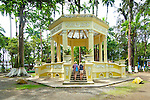 Tourists visit a neoclassic kiosk built in 1911 with art noveau animal designs located in the middle of Parque Vargas in the coastal Caribbean city of Limon, Costa Rica.