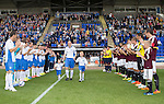St Johnstone v Hearts...03.08.14  Steven Anderson Testimonial<br /> Steven Anderson gets a gurad of honour as he walks on the pitch<br /> Picture by Graeme Hart.<br /> Copyright Perthshire Picture Agency<br /> Tel: 01738 623350  Mobile: 07990 594431