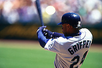 OAKLAND, CA - Ken Griffey Jr. of the Seattle Mariners bats during a game against the Oakland Athletics at the Oakland Coliseum in Oakland, California in 1996. Photo by Brad Mangin