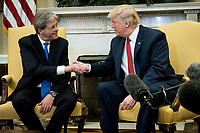 President Donald Trump meets with Prime Minister Paolo Gentiloni of Italy in the Oval Office of the White House in Washington, District of Columbia, U.S., on Thursday, April 20, 2017.  Trump and Gentiloni are meeting ahead of the G-7 industrialized nations meeting in Italy next month. Photographer: Pete Marovich/BloombergUnited States President Donald Trump meets with Prime Minister Paolo Gentiloni of Italy in the Oval Office of the White House in Washington, DC on Thursday, April 20, 2017.  Trump and Gentiloni are meeting ahead of the G-7 industrialized nations meeting in Italy next month. <br /> Credit: Pete Marovich / Pool via CNP /MediaPunch