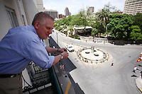 Television and radio host Glenn Beck looks over the balcony of his hotel room onto Alamo Plaza, Wednesday, April 15, 2009, in San Antonio. (Darren Abate/pressphotointl.com)