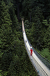 Tourists walking on Capilano suspension bridge North Vancouver British Columbia Canada