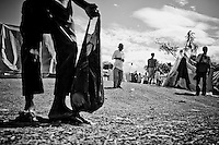 A boy stands with a bag in a camp for those displaced by the recent earthquake in Petionville, outside  Port-au-Prince, Haiti.
