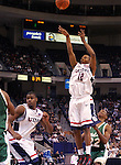 HARTFORD, CT. 02 January 2007-010207SV09--#12 A.J. Price of UConn puts up a shot against South Florida during basketball action at the Civic Center in Hartford Tuesday. <br /> Steven Valenti / Republican-American