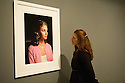 London, UK. 12.09.2012. EVERYTHING WAS MOVING, the changing world of the 60s and 70s captured by international photographers, opens in the Barbican art gallery. Picture shows a visitor looking at a William Eggleston portrait. Photo credit: Jane Hobson.