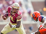 Florida State running back Jacques Patrick makes a move against Syracuse cornerback Corey Winfield in the first half of an NCAA college football game against Syracuse in Tallahassee, Fla., Saturday, Oct. 31, 2015.  Florida State defeated Syracuse 45-21. (AP Photo/Mark Wallheiser)