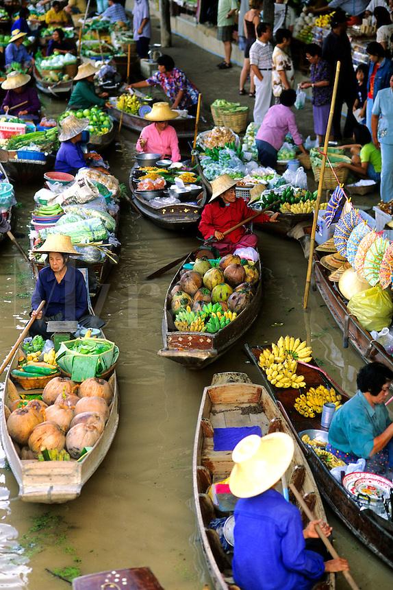 Color graphic image of shopping boats at the famous Floating Market at Damnernsaduak near Bangkok Thailand