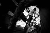 From Migrant worker serie..Maroc men worker  in a  frame machine  factory near Pavia Italy..In Italy there are a lot of migrant worker, Italian young workers do not want to work in factories they prefer offices and the services sector.