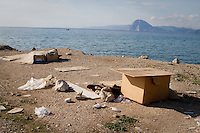 Belongings and a make shift bed on a beach in the Greek city of Patras.