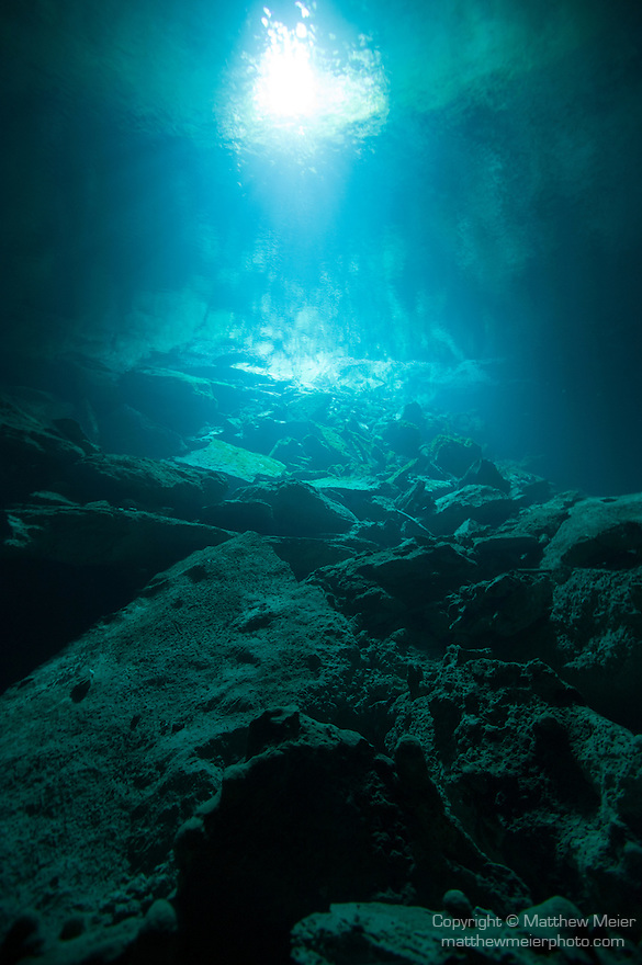 Grand Bahama Island, The Bahamas; a view of the main cavern in Ben's Cave, looking back towards the water's surface and diver's entry point, the main cavern is approximately 200 feet long, 100 feet wide and 50 feet deep, there is freshwater in the first 25-30 feet and saltwater below, the freshwater makes the limestone white, while the saltwater below the halocline turns it dark