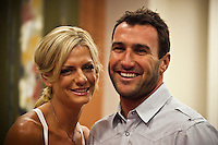 """COOLANGATTA, Australia (Thursday, February 26, 2009) - .JOEL PARKINSON (AUS) and his wife Monica  at the ASP World Champions' Crowning took place tonight at the Gold Coast Convention and Exhibition Centre beginning at 6:30pm.. .Surfing's """"night of nights"""", the ASP World Champions' Crowning, was a gala event, hosting the world's best surfers as well as distinguished figures from the surfing industry in honor of the 2008 ASP World Champions.. .Kelly Slater (USA), 36, reigning and nine-time ASP World Champion, accepted his unprecedented ninth ASP World Title award just days before beginning his hunt for an incredible 10th Crown at the upcoming Quiksilver Pro Gold Coast presented by LG Mobile.. .Stephanie Gilmore (AUS), 21, reigning two-time ASP Women's World Champion, received her second consecutive ASP Women's World Title cup, and the young natural-footer will soon embark on a campaign to make it a three-peat in 2009. Gilmore will begin this weekend at the opening event of the 2009 ASP Women's World Tour season, the Roxy Pro Gold Coast presented by LG Mobile.. .Other ASP Dream Tour athletes  recognized were respective Runner-Ups Bede Durbidge (AUS), 25, and Silvana Lima (BRA), 24, as well as Rookies of the Year Dane Reynolds (USA), 23, and Nicola Atherton (AUS), 22.. .Bonga Perkins (HAW), 36, and Joy Monahan (HAW), 22, took out the ASP World Longboarding and ASP Women's World Longboarding Titles respectively, while Nathaniel Curran (USA), 24, and Sally Fitzgibbons (AUS), 18, took home hardware for their respective No. 1 finishes on the ASP World Qualifying Series last season.. .In addition to honoring the champions from 2008, the ASP World Champions' Crowning also recognized athletes who  earnt the 2008 ASP World Tour 'Most Improved',  a tie between Adrian Buchan (AUS) and Adrian de Souz (BRA) the 2008 ASP Women's World Tour 'Most Improved', the ASP Service to the Sport Award and the prestigious Peter Whittaker Award take out by Taylor Knox (USA)."""