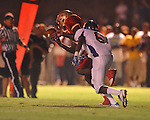 Lafayette High's Brandon Mack (4) intercepts a pass thrown to Oxford High's Stan Ivy (6) at William L. Buford Stadium in Oxford, Miss. on Friday, September 2, 2011. Lafayette won 40-12