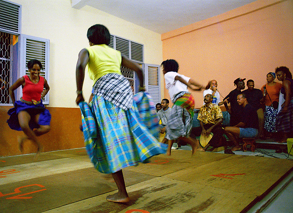 Traditional Belle dancers dance together at a local school in downtown Fort-de-France. They are part of a folk dance club that meets once a week to dance together and have fun. Fort-de-France, Martinique. Eastern Caribbean.