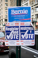 Signs encouraging voter registration and promoting Democratic presidential candidate Bernie Sanders in New York on Saturday, March 19, 2016.  (© Richard B. Levine)