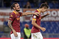 Calcio, Serie A: Roma vs Palermo. Roma, stadio Olimpico, 4 novembre 2012..AS Roma forward Erik Lamela, of Argentina, right, is congratulated by teammate Pablo Daniel Osvaldo after scoring during the Italian Serie A football match between AS Roma and Palermo, at Rome's Olympic stadium, 4 november 2012..UPDATE IMAGES PRESS/Riccardo De Luca
