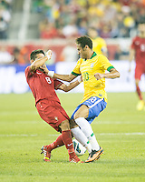 Brazil forward Neymar (10) fends off Portugal midfielder Joao Moutinho (8).  In an International friendly match Brazil defeated Portugal, 3-1, at Gillette Stadium on Sep 10, 2013.