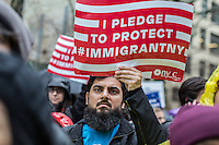 "NEW YORK, NY - DECEMBER 18 : A man stands with a sign during the ""March for Immigrant New York"" to pledge for protecting Immigrants from Anti-Immigrant Policies on the International Migrant Day in New York City on December 18, 2016. VIEWpress/Maite H. Mateo"