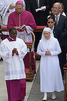 Sister Marie Simon Pierre ,Pope Francis during the canonisation mass of Popes John XXIII and John Paul II on St Peter's at the Vatican on April 27, 2014.