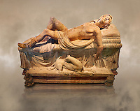High picture of the Etruscan funerary monument  known as  Adonis Dying, late 3rd century BC, made of terracotta and discovered near Tuscania, inv 14147, The Vatican Museums, Rome. Grey art Background. For use in non editorial advertising apply to the Vatican Museums for a license.