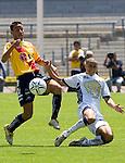 UNAM Pumas defender Dario Veron (R) is fouled by Monarcas' Morelia Ivan Moreno during their soccer match at the University Stadium , March 12, 2006. UNAM PUMAS won 1-0 to Monarca's Morelia. © Photo by Javier Rodriguez