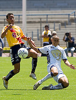 UNAM Pumas defender Dario Veron (R) is fouled by Monarcas' Morelia Ivan Moreno during their soccer match at the University Stadium , March 12, 2006. UNAM PUMAS won 1-0 to Monarca's Morelia. © Photo by Javier Rodriguez