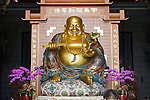 A golden, Chan style Buddha greets visitors to Chung Tai Chan Temple.