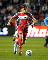 Chicago midfielder Baggio Husidic (9) dribbles down the field.  The Chicago Fire tied Chivas USA 1-1 at Toyota Park in Bridgeview, IL on May 1, 2010.