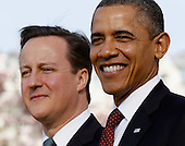 U.S. President Barack Obama (R) and British Prime Minister David Cameron participate in an official arrival ceremony on the South Lawn of the White House March 14, 2012 in Washington, DC. Cameron was on a three-day visit in the U.S. and he was expected to have talks with Obama on the situations in Afghanistan, Syria and Iran..Credit: Chip Somodevilla / Pool via CNP