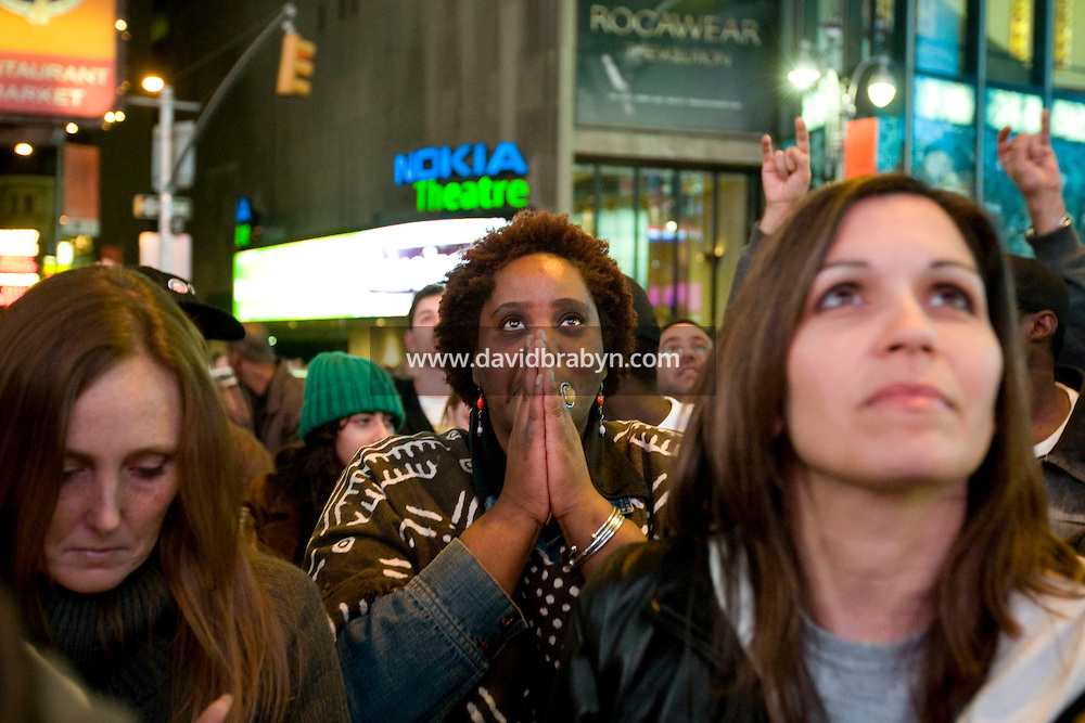 Monamma AL-Ghuiyy (C) gets emotional as she watches television coverage of the 2008 US presidential election results on a giant screen on Times Square in New York, NY, United States, and Barack Obama's favorable results come in, 4 November 2008.
