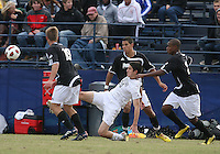 Andy Riemer #20 of Georgetown University sends the ball away from Daniel Fabian #19 of Providence University during a Big East quarter-final  match at North Kehoe Field, Georgetown University on November 6 2010 in Washington D.C. Providence won 2-1.
