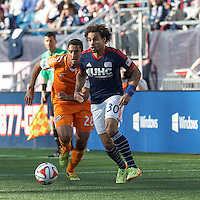 New England Revolution defender Kevin Alston (30) looks to pass. In a Major League Soccer (MLS) match, the New England Revolution (blue/white) defeated Houston Dynamo (orange), 2-0, at Gillette Stadium on April 12, 2014.