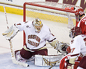 The puck sits loose in front of John Muse (BC - 1). - The Boston College Eagles defeated the visiting Boston University Terriers 5-2 on Saturday, December 4, 2010, at Conte Forum in Chestnut Hill, Massachusetts.