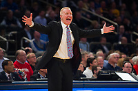 NEW YORK, NY - Thursday March 9, 2017: St. John's head coach Chris Mullin directs his team against Villanova as the two schools square off in the Quarterfinals of the Big East Tournament at Madison Square Garden.
