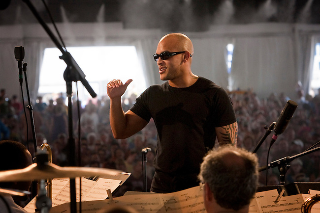 Trumpeter Irvin Mayfield of Irvin Mayfield and the New Orleans Jazz Orchestra directs and performs on the WWOZ Jazz Tent stage at the New Orleans Jazz and Heritage Festival at the New Orleans Fair Grounds Race Course in New Orleans, Louisiana, USA, 1 May 2009.