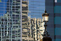 Historic street lamp against modern architecture.<br />