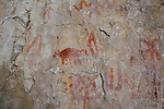 Indian pictographs on a rock wall near the shore of the Smith River in Montana