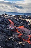 A man hikes through lava fields in Hawai'i Volcanoes National Park, Hawai'i Island.