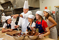 Summer campers learn culinary arts at Johnson & Wales University's Charlotte NC campus in downtown Charlotte. The Chef's Choice Camp is taught by professional chefs in Johnson & Wales modern, state-of-the-art facilities. Campers ages 10 to 17 learn hands-on cooking and baking techniques in the five-hour classes.