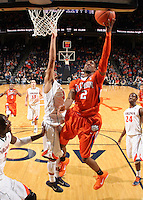 Feb. 2, 2011; Charlottesville, VA, USA; Clemson Tigers guard Demontez Stitt (2) shoots next to Virginia Cavaliers guard Mustapha Farrakhan (2) during the game at the John Paul Jones Arena. Virginia won 49-47. Mandatory Credit: Andrew Shurtleff